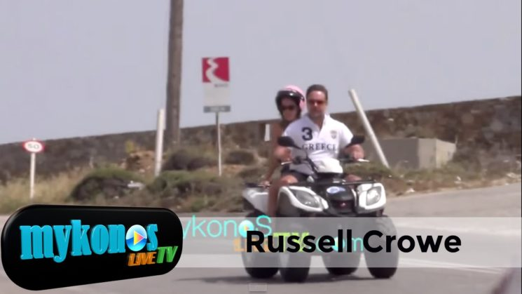 Russell Crowe with friends driving on quad around Mykonos